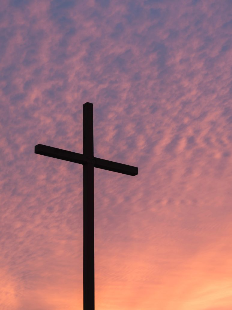 cross with purple sky and clouds